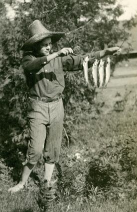 Young Ernest Hemingway with fish