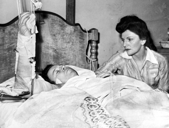 Walter Reuther recuperates after the 1948 attempt on his life. His wife May watches over him. (Photo courtesy of Walter P. Reuther Library, Wayne State University)